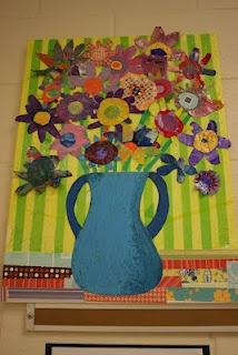 Great LARGE class project for Art Auction. Each student could decorate a small cardboard flower.