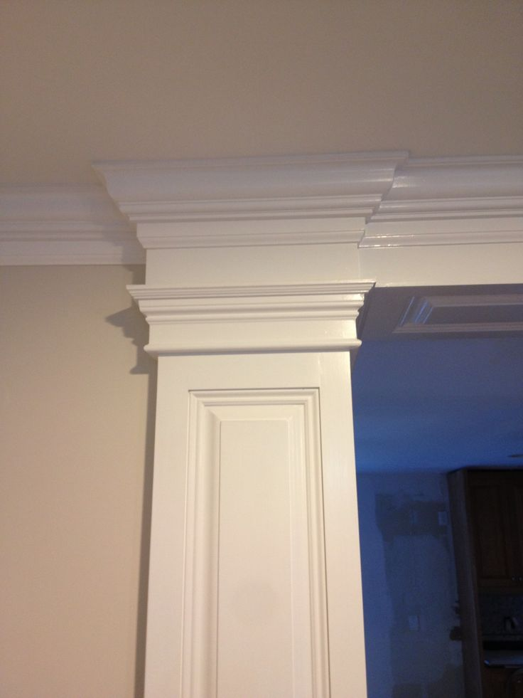 Columns hide laundry vent behind bulkhead covered with Crown columns