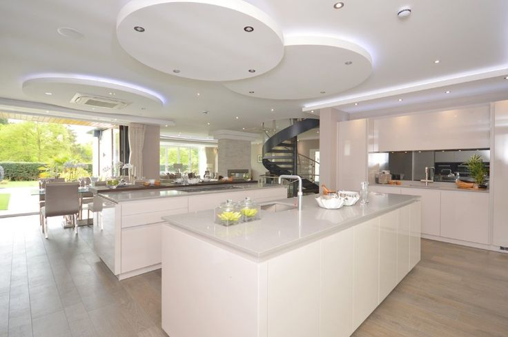 Grey kitchen flooring- super neutral cool tones- all white walls and cabinets- custom ceiling lighting