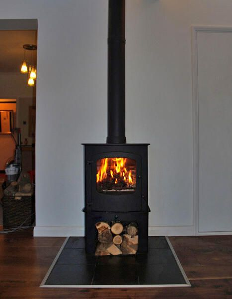 Charnwood Cove 2 #woodstove with log stand and natural #slate tiled #hearth pic.twitter.com/8e5dyAIxh7
