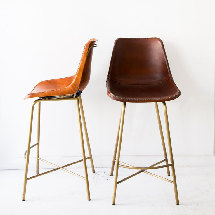 "A saloon-style bar stool made of hand whip stitched leather and brass legs. - Dimensions: 38""H x 17""W x 18""D; Seat: 27""H - Materials: Leather; Brass - Finish: Dark Brown; Brass - Made to look and feel"