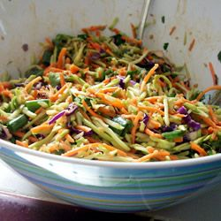 Asian Coleslaw | This is a three cabbage slaw - green, red, and napa - but the real delight is the dressing. It is made with creamy peanut butter laced with brown sugar, fresh ginger, and garlic - and a bit of oil, vinegar, and soy sauce.