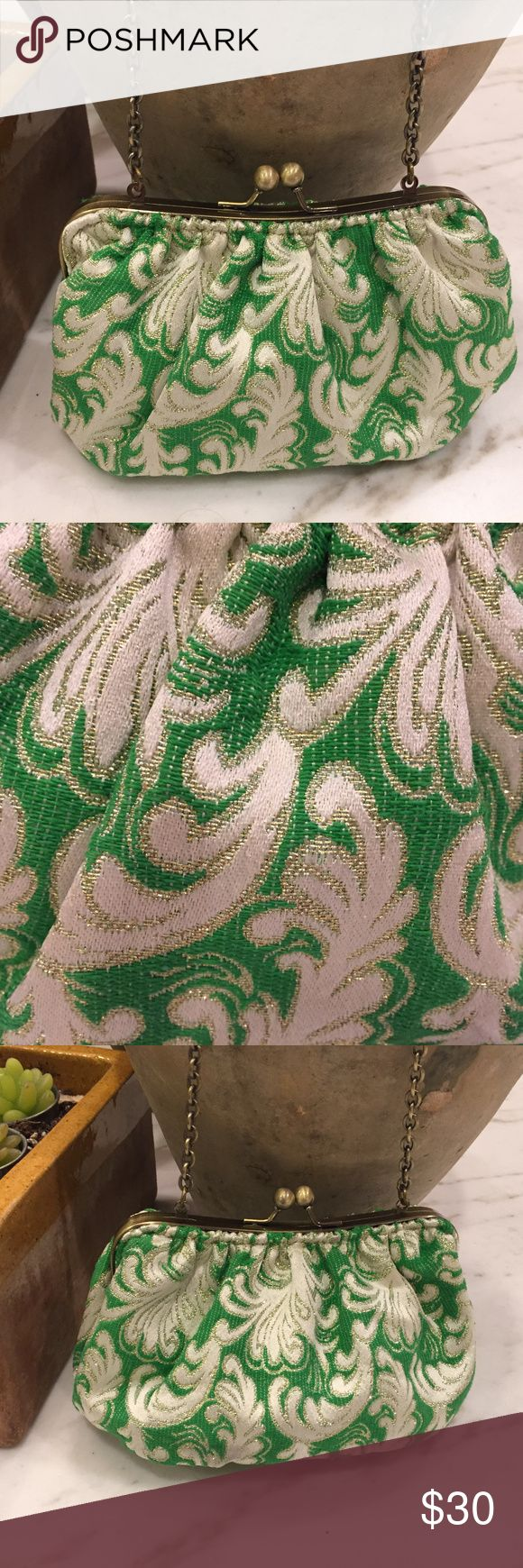 "Precious Amrita Singh Evening Bag This looks like a broadcloth or tapestry, vivid green and white, with gold thread running through.  It is lined with beige suede.  This has an oval bottom so you can set it down, once you have put your belongings in there, unlike a true pouch.  This purse is 8"" x 4"".  The oval bottom, at the largest parts 6"" x 3"".  The chain is 20"" long.  I have no idea what I paid for this.  So, if you find one for less, let me know. Amrita Singh Bags Clutches & Wristlets"