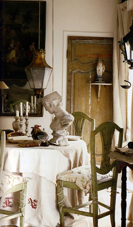 The bust, the lantern, the embroidered linen