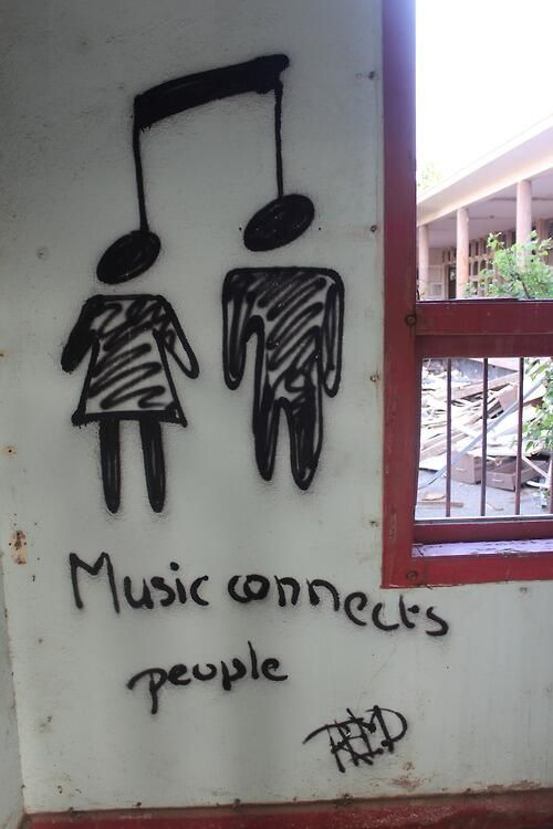 this is honestly, one of the most accurate drawings about music, I've ever seen. when you listen to music you're connected to the band by the lyrics and their story, and you connect with other fans that you can share your story with and so on, I really love music and I think its the most powerful way to talk/connect with others.