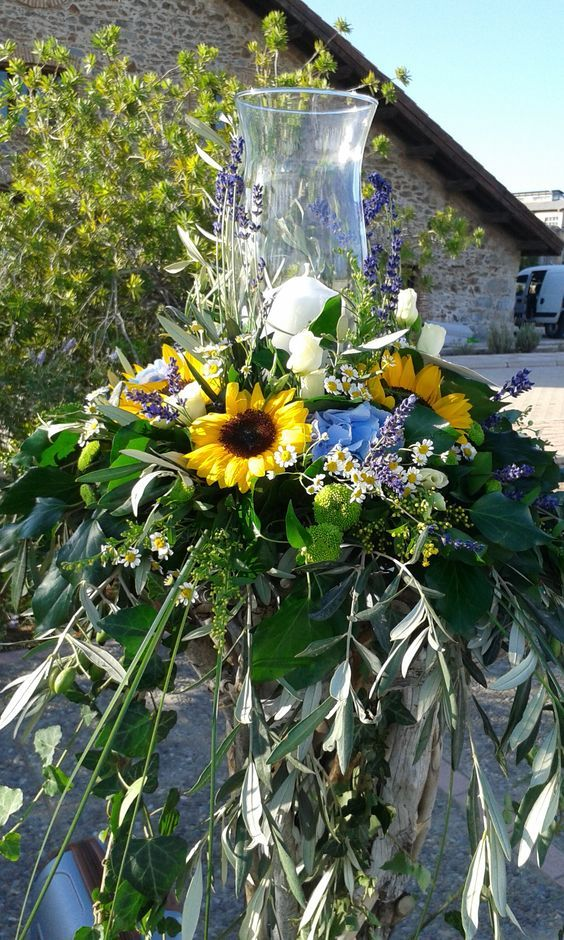 candles decorated in sea-sun colours with sunflowers,hortansias,levanders and greenery  by flowers papadakis  tel 00302109426971 info@flowers4u.gr: