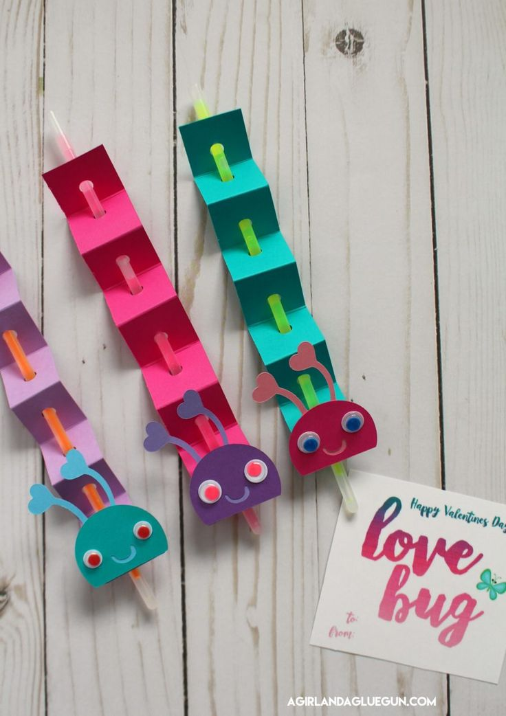 """This post may contain affiliate links  Another fun """"Tanya craft""""! She whipped these up during our Bachelor vegfest (who else despises Corinne?) Such a cute and easy craft–and perfect if you don't want to hand out candy for Valentine's Day! Cut strips of paper and score every inch and bend back and forth (paper …"""