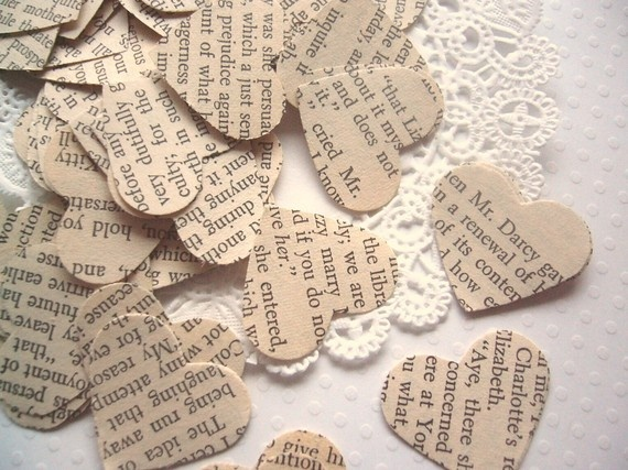 Flower girl to throw paper hearts punched from a vintage book instead of flower petals .
