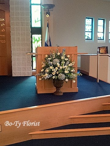 Wedding Flowers - Bimah Arrangement in blue and white flowers.