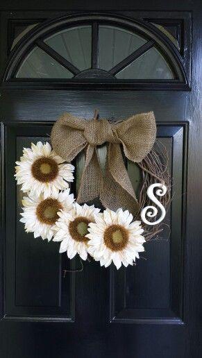 Monogramed grapevine wreath with white sunflowers and burlap bow. http://media-cache-ak0.pinimg.com/originals/da/73/06/da7306857a91afef5267828ddeea533a.jpg