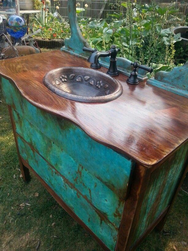 Old scarred oak dresser into SK' bath vanity. SK on Elderberry.
