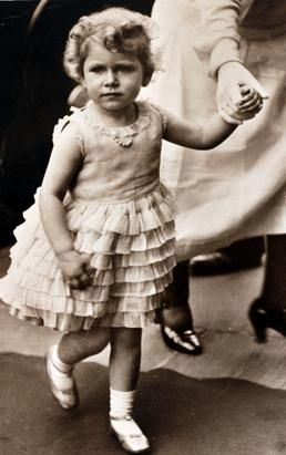 Princess Elizabeth wears a dress with tiered frills circa 1930.