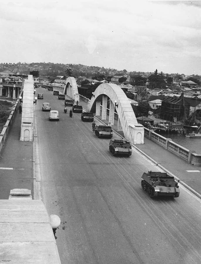 Military vehicles crossing the William Jolly Bridge in Brisbane, with views to the suburb of South Brisbane.