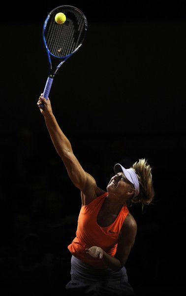 WELCOME BACK MARIA!!!!!!!!!! Maria Sharapova Photos Photos - Maria Sharapova of Russia serves during her match against Erkaterina Makarova of Russia during the Porsche Tennis Grand Prix at Porsche Arena on April 27, 2017 in Stuttgart, Germany.