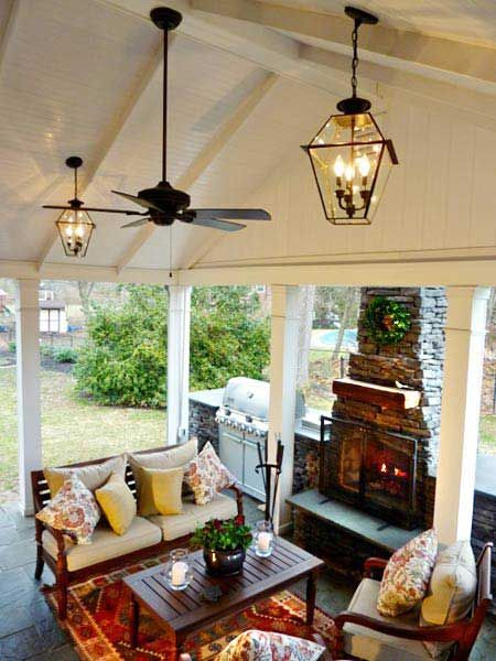 Removing doors and glass, vaulting the ceiling, and adding an outside wall which houses a new fireplace, a built-in grill, and a drink station transformed this once little-used enclosed sunroom into a popular hangout. | thisoldhouse.com