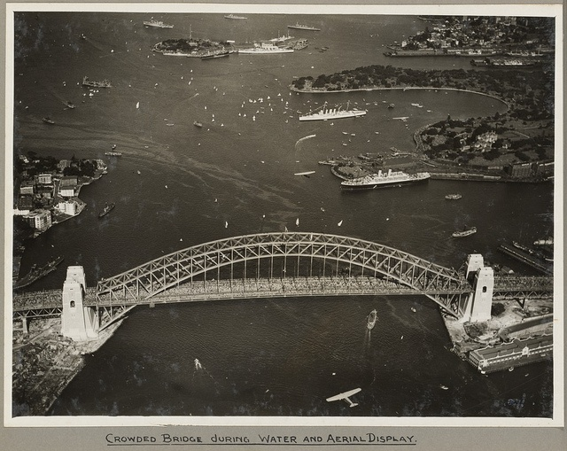 Sydney Harbour Bridge crowded with onlookers during the water and aerial display, 19 March 1932 by National Library of Australia Commons, via Flickr