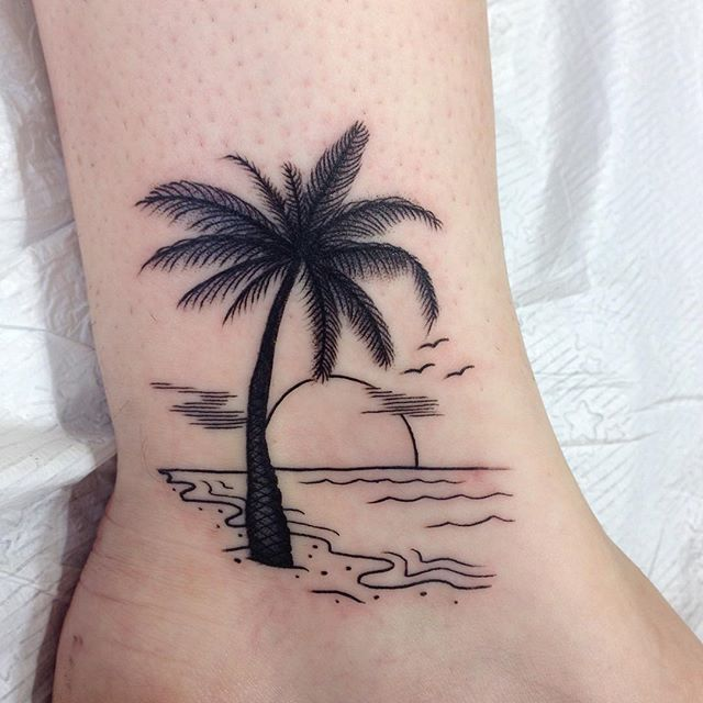 Rising Sun On Beach And Palm Tree Tattoo On Ankle Rising