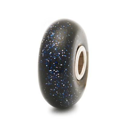 Item Number: 62024 - This bead left the collection in 2014.   The Blue Goldstone is actually a man-made bead of glass, sprinkled with glittering stardust radiating energy. It represents wisdom and science, and it is said to bring you luck and aid you as you reach for the stars.  Designer:  Lise Aagaard  Release date: 2011