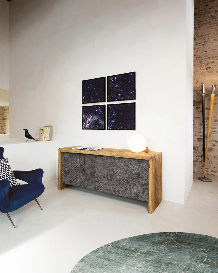WRAP | An unmissable piece in classic furniture is reinvented with style by Nature Design making it perfect for a modern and design environment. The antique wood structure of the sideboard and its doors in silk-screened metal or slate stone, make it unique and perfectly recognizable. #NatureDesign #MadeinItaly