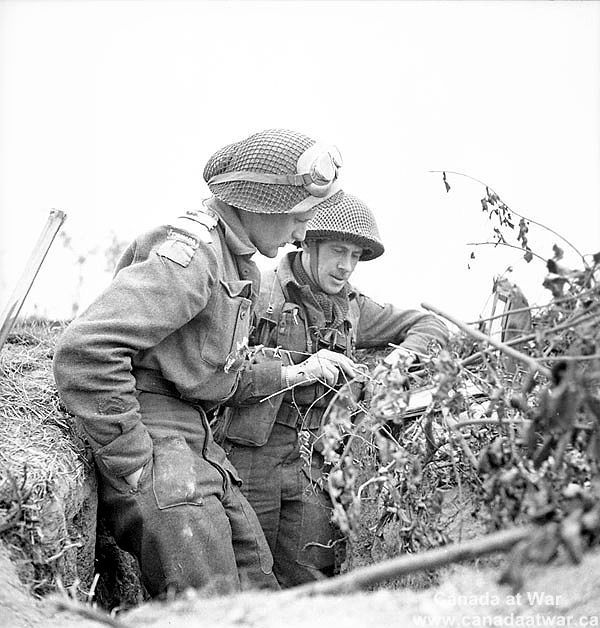 Officers of the Queen's Own Rifles of Canada discussing tactics. July 8, 1944…