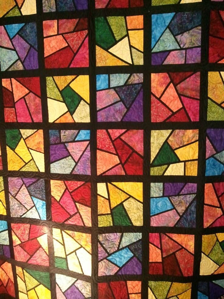 Use batik fabric to create this quilted stained glass window effect! @Craftsy