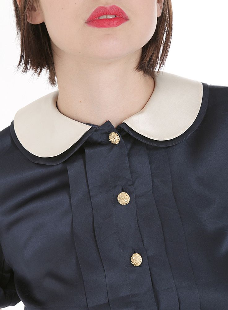 Blouse: http://retrock.com/collections/womens-blouses/products/dark-blue-blouse-with-golden-buttons-and-white-collar