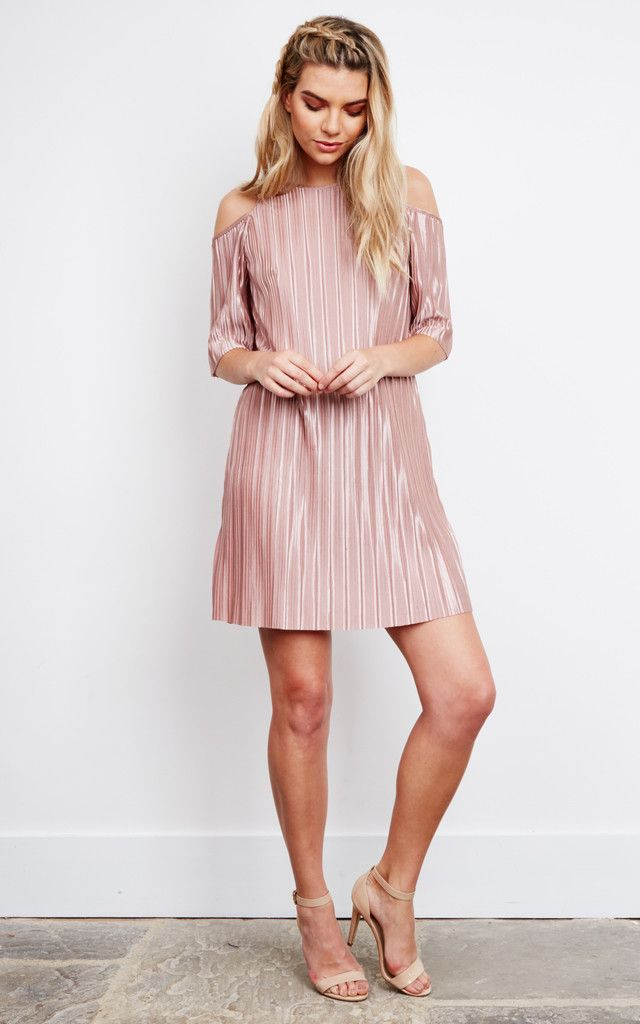 This pink metallic dress is a true head turner. It's the perfect girls night out outfit with a flattering a-line fit and sexy cold shoulder design.