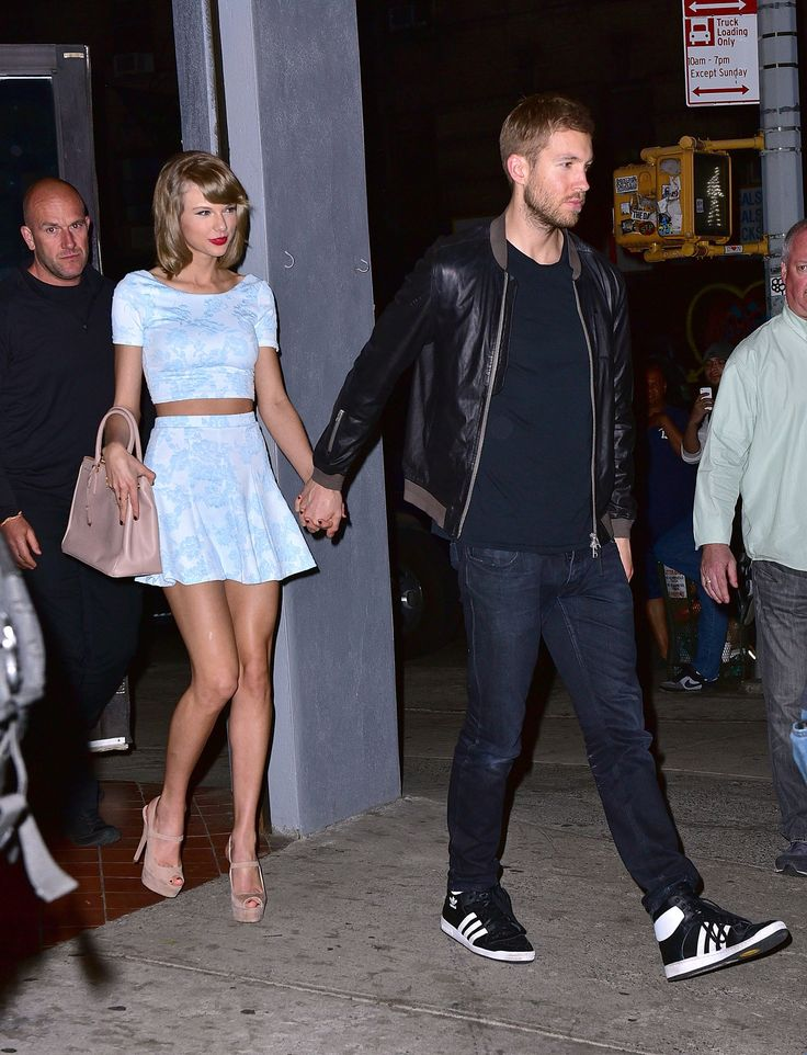 In an AQUA skirt and crop top with Calvin Harris in New York City.   - ELLE.com