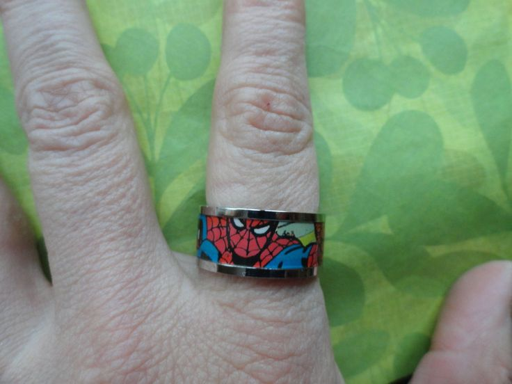 Superman printed stainless steel ring. Fun superman ring has printed comic paper for funky look. SIZE 8 ONLY LICENSED