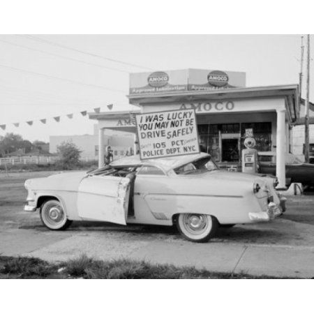 Crushed car with information board about driving safely Canvas Art - (24 x 36)