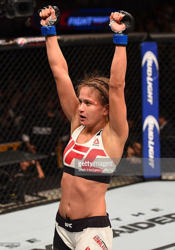 Karolina Kowalkiewicz celebrates her victory over Randa Markos in their women's strawweight bout during the UFC Fight Night event at the Amway Center on December 19, 2015 in Orlando, Florida.