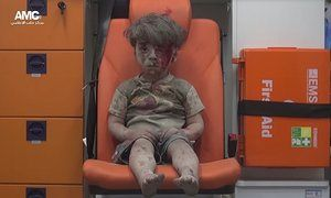 Boy in the ambulance: shocking image emerges of Syrian child pulled from Aleppo rubble | World news | The Guardian