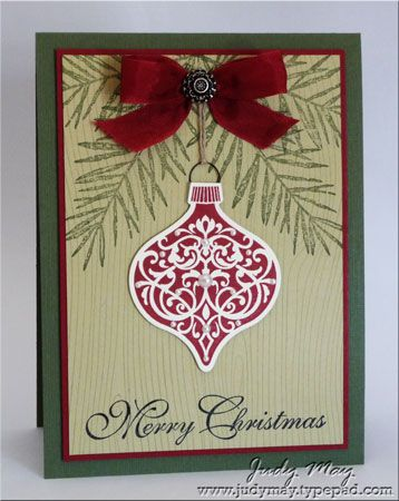 Stampin' Up! Christmas card ... country colors of deep red and green with kraft ... like the woodgrain tone on tone stamped background ... Christmas bauble ... red bow with fancy brad ... like it!