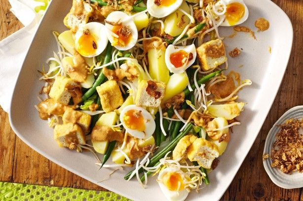 Gado gado, a vegetable salad served with peanut sauce and boiled eggs, is a classic Indonesian dish. We have added tofu puffs for an extra twist.