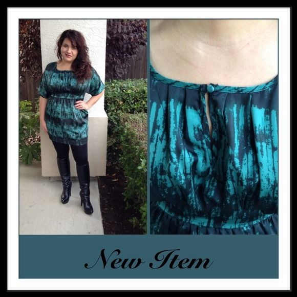"""Emerald City Dress Very gently worn, this super adorable mini dress will make you the queen of emerald city! hehe It has a thick waist band that is fun and flirty and a cute little peek-a-boo in the front of the neckline that is fastened with a button. The neckline is almost a square which is super cute! Great dress!All OFFERSmust be made through Poshmarks """"offer feature"""". Price negotiation for bundles in the comment section will only be accepted. Thank you for understanding! Happy Poshing…"""