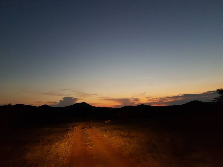 H I T . T H E . R  O A D !! Amazing view just outside of camp No filter needed  #mountain #sunset #photography #androidgraphy #colour #hittheroad #evening #road #africa #travelgram #instagram #blue #sky #coldnights #savannah #southafrica #traveller #photographer #samsung #instagood #nevergetboredofthis #wanderlust #yellow #orange #wildlife #outdoor #travel #potd #botd #enoughhashtags http://tipsrazzi.com/ipost/1507961672799008918/?code=BTtWybiFriW