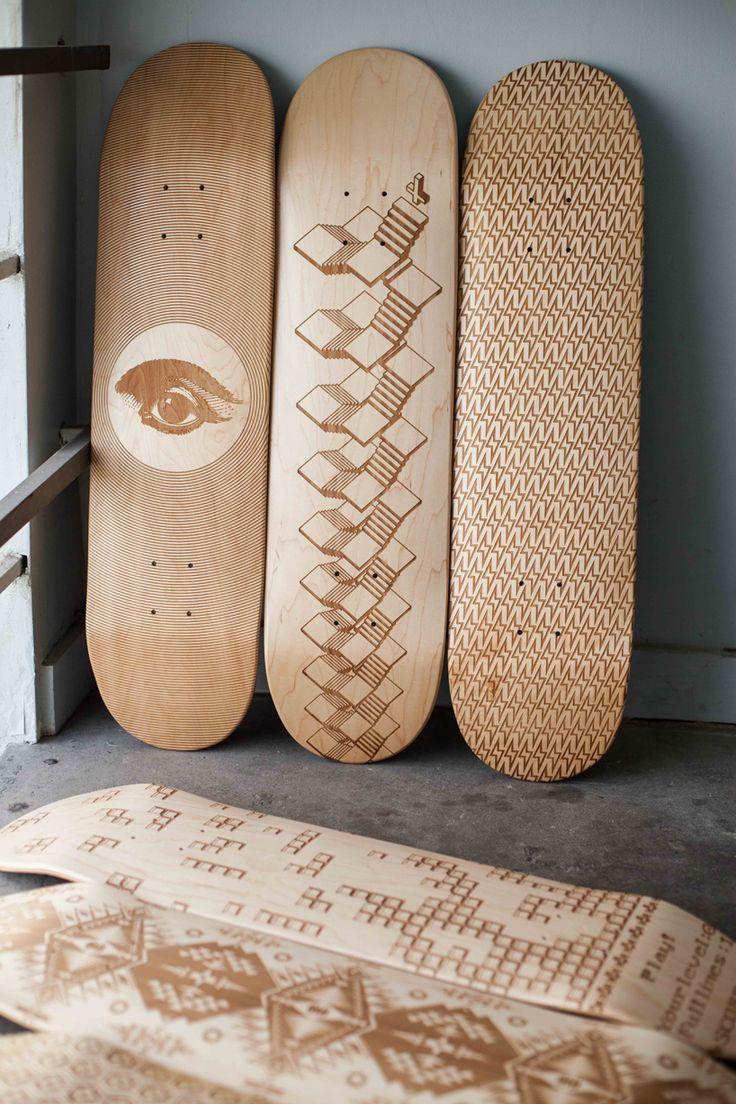 Laser engraved skateboard decks by magnetic kitchen.