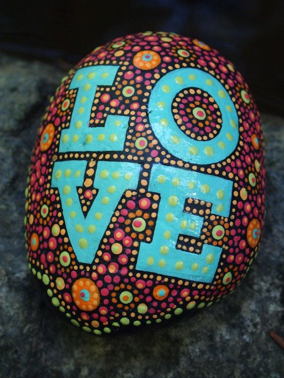Love painted stone, part of my Written on Stone series. Stones painted with inspirational words.  The finished stone is art for your eyes, inspiration