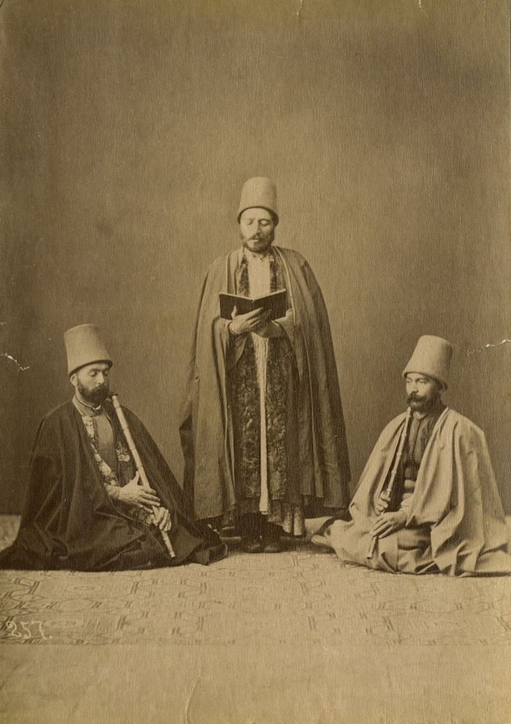 Three Mevlevi (Dervish) performers.  Istanbul, ca. 1880.  (Photographer: Sebah, Pascal).