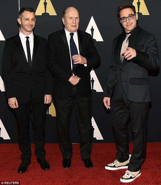 Castmates: The Iron Man actor posed alongside actors (L-R) Jeremy Strong and Robert Duvall - the trio star in drama The Judge together