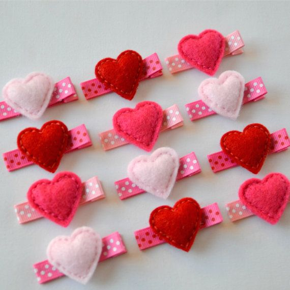 Valentines Day Small Puffy Hearts Felt Hair Clip - Red, Light Pink, Hot Pink Felt Hearts hair bows. $3.25, via Etsy.