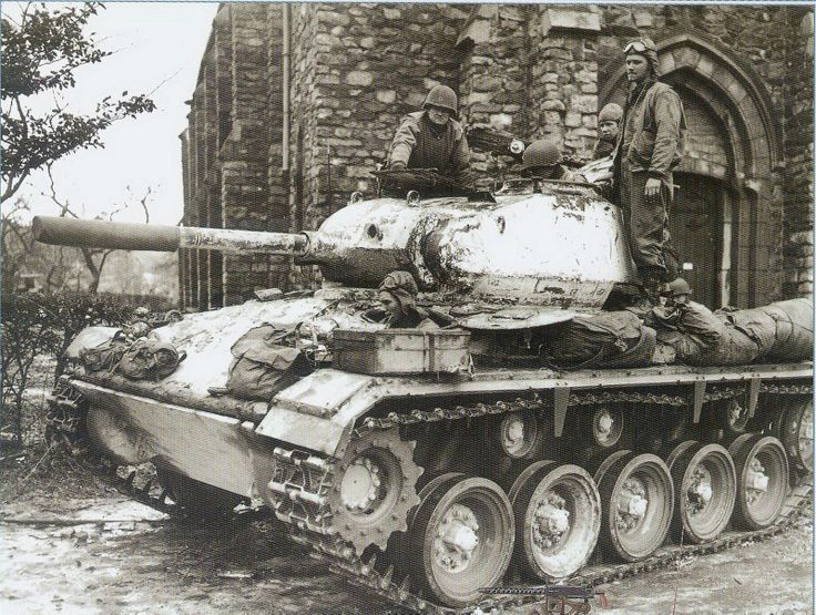 M24 Chaffee light tank of 18th Cavalry Squadron (Mechanized), 14th Cavalry Group (Mechanized), First Army. The vehicle wears whitewash camouflage. The 14th Cavalry was severely mauled in the opening days of the German Ardennes offensive, holding a critical juncture between V and VIII Corps at the Losheim Gap.