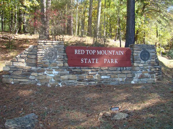 Located 45 minutes north of Atlanta near Cartersville, Georgia, Red Top Mountain State Park, on Lake Allatoona, is ideal for swimming, water skiing, and fishing. Named for the soil's rich red color caused by high iron-ore content, Red Top Mountain was once an important mining area.