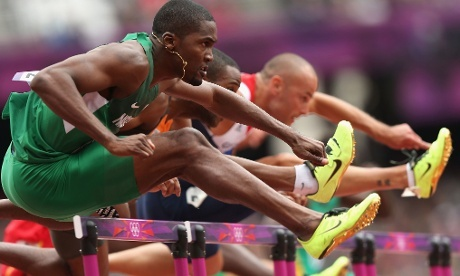 Selim Nurudeen of Nigeria, Gregory Sedoc of Netherlands and Andrew Turner of Great Britain compete in the Men's 110m Hurdles Round 1 Heats and show the popularity of this year's must-have yellow track shoe! Photograph: Ezra Shaw/Getty Images  2012 London Olympics