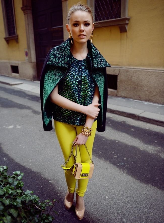 emerald green leather jacket with yellow trousers