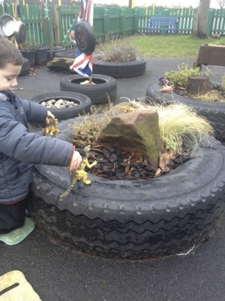 Dinosaurs-Outdoors should be outdoors NOT just indoors taken outside - mini gardens in tyres #abcdoes #eyfs #outdoorarea