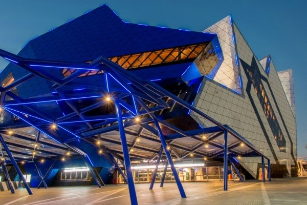 Perth Arena, Eternity puzzle in Perth. Its bold, puzzle-inspired exterior made with ALUCOBOND® in Custom Colour Arena Blue, Cream, Black, Sparkling White and Silver Metallic reflects its role as Perth's premier venue for large-scale sport and entertainment events.