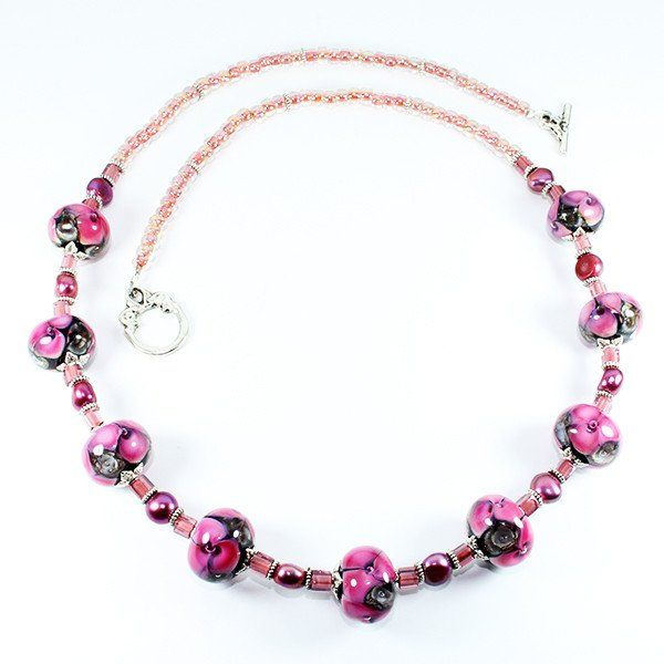 Seaviolet Pink Murano Glass Beaded Necklace that represents the essence of the Seaviolet Flower. Hand crafted using centuries old Murano glass lampwork techniques. Length:50cm Every piece is unique and may differ slightly from the image displayed.
