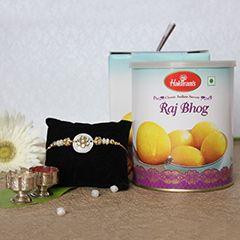Buy and send online sets of 1 and Raj Bhog combo via sendrakhi.com