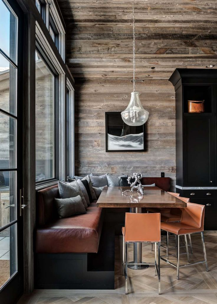 L-shaped banquette. Rustic and modern materials. Reclaimed snow fencing clad walls & ceiling. #Banquette